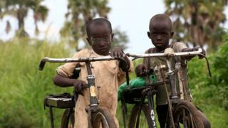 Refugee children from South Sudan ride their bicycles at Palorinya settlement in Moyo district northern Uganda October 25, 2017, released on 8 November 2017