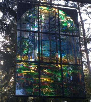 Stain-glass window artwork in a forest
