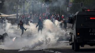 Demonstrator clash with soldiers in Santiago