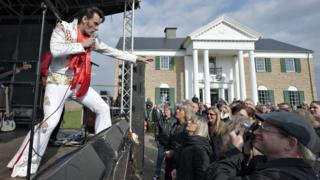 An Elvis lookalike performs at the inauguration of the Elvis museum in Denmark