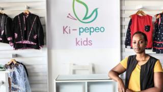Priscilla Ruzibuka akiwa akinadi nguo za watoto chini ya nembo Ki-pepeo Kids