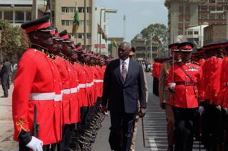 Daniel arap Moi shown inspects the honour guard at the opening of Parliament in Nairobi in 1992.