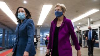 Democratic Senator from Washington Maria Cantwell (L) and Democratic Senator from Massachusetts Elizabeth Warren (R) walk to the Senate chamber as the Senate meets, 5 March