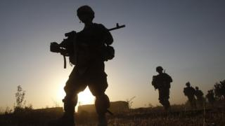 A silhouette of soldiers