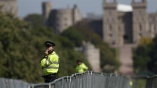 Police patrol along the Long Walk outside Windsor Castle in Windsor