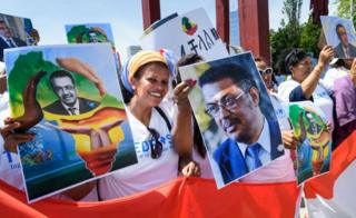 People hold placards picturing Ethiopian Candidate for the post of Director General of World Health Organization (WHO) Tedros Adhanom Ghebreyesus, during a rally on his support, in front of the United Nations offices.