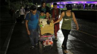 Migrants leave San Pedro Sula in Honduras on 15 January 2019