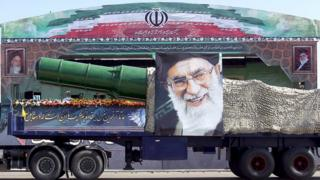 A military truck carrying a missile and a picture of Iran's Supreme Leader Ayatollah Ali Khamenei is seen during a parade marking the anniversary of the Iran-Iraq war (1980-88) in Tehran on 22 September 2015