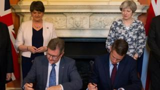 The DUP and Conservative party sign their confidence and supply agreement