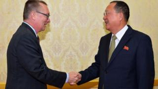 North Korea's Foreign Minister Ri Yong-Ho shakes hands with with Jeffrey Feltman