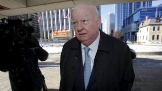 Senator Mike Duffy, who is on trial for fraud, bribery and breach of trust, arrives at the courthouse in Ottawa, Canada