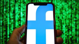 Facebook logo on a smartphone