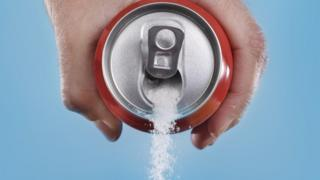 Sugar pouring out a can