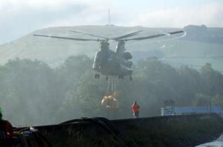 Chinook hovers over dam