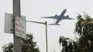 Plane flying near protest sign