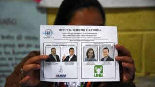 An indigenous woman shows a ballot at a polling station during runoff elections in Santa Cruz Chinautla, Guatemala, on 11 August.