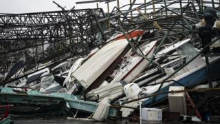 A warehouse of boats is damaged at Treasure Island Marina after Hurricane Michael made landfall along the Florida Panhandle, 10 October 2018