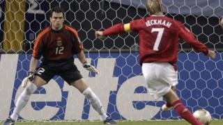 David Beckham scores a penalty against Argentina.