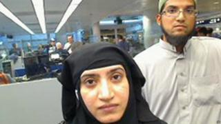 Tashfeen Malik and Syed Farook in a government photo as they passed through O'Hare International Airport