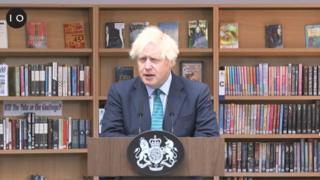 Boris Johnson talks to pupils in library