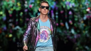 US designer Jeremy Scott greets the audience at the end of the show for fashion house Moschino during the Women's Spring/Summer 2018 fashion shows in Milan, on September 21, 2017