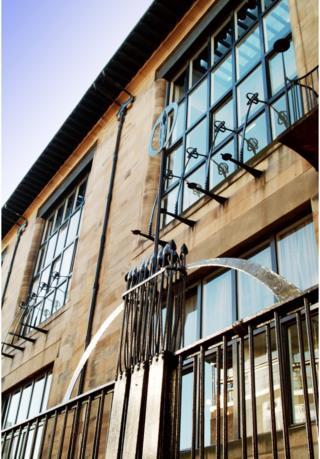 Abstract detailed shot of Mackintosh Building facade from Renfrew Street showing studio windows