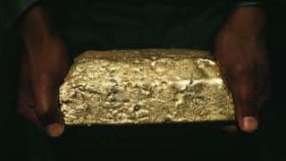 positive people Man holding a gold ingot
