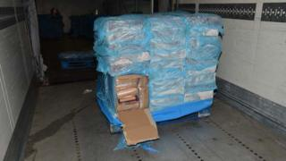 A pallet with a box containing cocaine