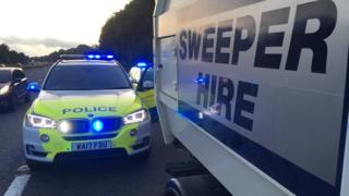 Police and road sweeper