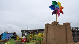 Giant pin wheel exhibit at Dismaland