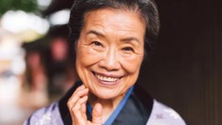 Una japonesa sonriendo