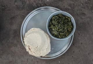 A meal is served in the Palorinya refugee camp