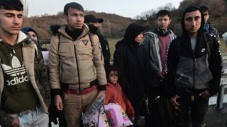 Migrants in Greek custody at the border with Turkey near Kastanies, 3 March