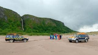 Coastguard vehicles and rescue crews at the scene of the crash on Benone Strand