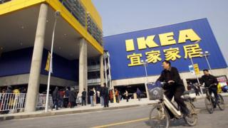 Customers cycle past an Ikea in China's west Chengdu
