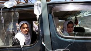 Afghan school girls receive medical treatment outside a local hospital after being admitted for symptoms of poisoning, in Herat, Afghanistan, 07 September 2015