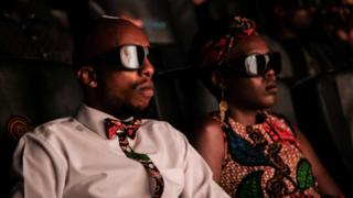 "Invited guests watch the film ""Black Panther"" in 3D in Nairobi, Kenya, on February 14, 2018"