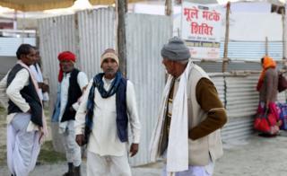 Men outside Bhule Bhatke Shivir in Allahabad