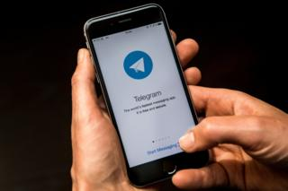 Telegram messaging app is seen on a smart phone