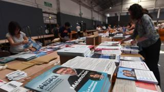 Employees prepare election leaflets for the upcoming French legislative elections on June 2, 2017 in Marseille, southern France