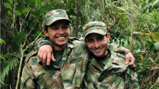 A handout photo released by Colombian Defensoria del Pueblo shows two Colombian professional soldiers Kleider Antonio Rodriguez (L) and Andres Felipe Perez posing after being released by the ELN guerrillas in Arauca, Colombia, 16 November 2015