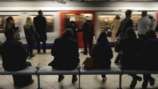 People waiting at a Tube station