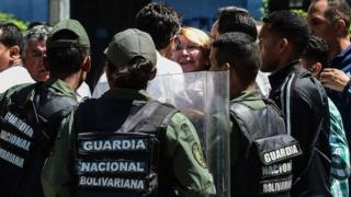 Venezuela's chief prosecutor Luisa Ortega (C) is surrounded by people and national guards during a visit to the Public Prosecutor's office in Caracas on August 5, 2017