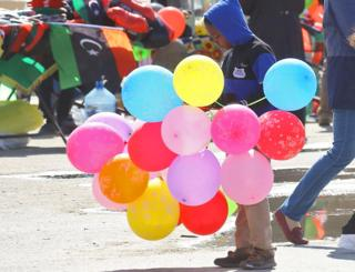 A boy selling balloons to celebrate in Martyrs Square, Tripoli, Libya - Saturday 17 February 2019