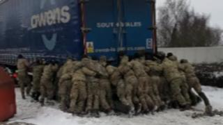 Soldiers pushing a lorry in the snow at Magor