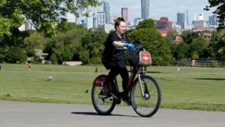 Woman on bike in Brockwell Park