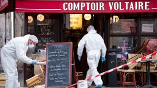Forensics officers outside the Comptoir Voltaire cafe