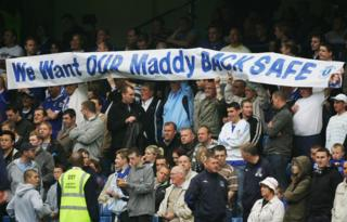 in_pictures Everton fans hold a banner appealing for the safe return of Madeleine McCann prior to the Barclays Premiership match between Chelsea and Everton at Stamford Bridge on 13 May 2007 in London
