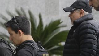 Police arresting former Brazilian Finance Minister