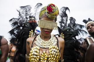 Revellers take part in the Caribbean Carnival Grand Parade in Toronto